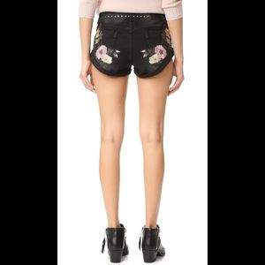 Birds of Paradise floral embroidered jean shorts